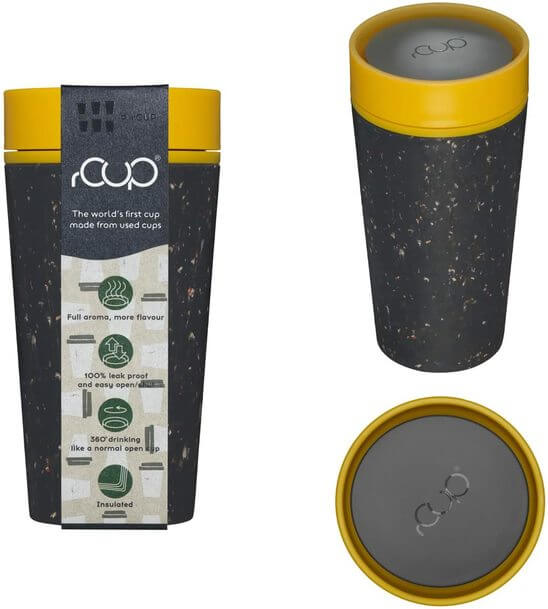 Picture of grey speckled and yellow sustainable travel coffee cup. it is shaped like a funnel, with a flat lit.