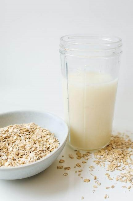 Picture of oat milk in a glass.